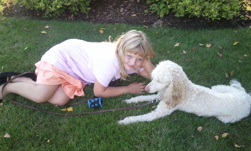Mini Poodle Miss Molly and our daughter Olivia