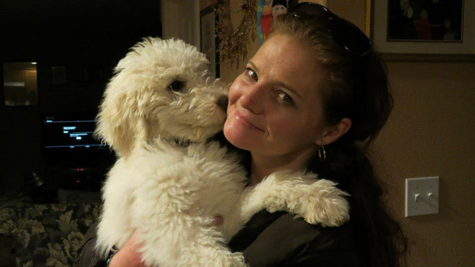"Me holding our standard poodle puppy ""Pele""!"