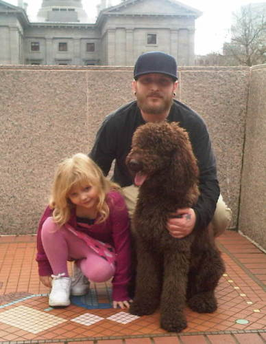 Daisy is a Daddy's Girl - Big Time! This is my husband Roy and my daughter Olivia with Daisy in Portland!